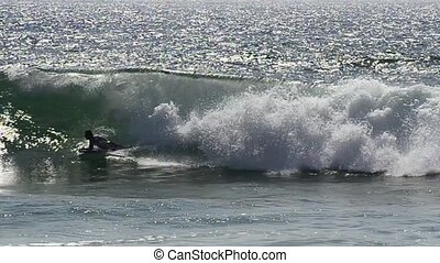 Body boarder riding a big wave