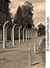 Auschwitz Birkenau concentration camp. - Fence and...