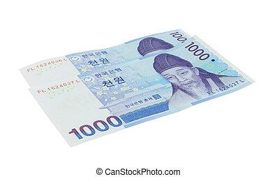 korean won - two korean won money notes over white