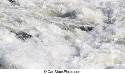 Fast running white water rapids.