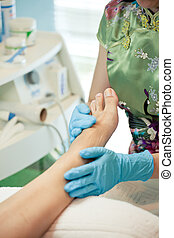 moisturizing and massage feet pedicure procedure -...