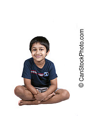 smiling - An handsome Indian kid sitting and smiling