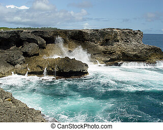 North Point, Barbados - The rugged coral rocks and foamy sea...