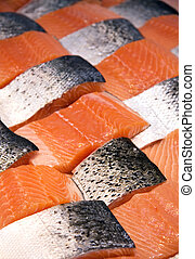 Salmon fillets - Fillets of salmon arranged in a patchwork...