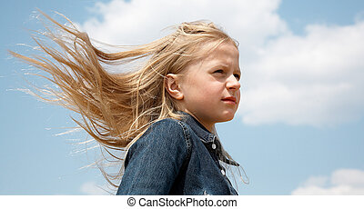 Hairs on the wind - Young blonde girl with hairs flying on...