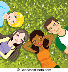 Resting in Clovers - Four multi ethnic boys and girls...