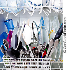 Dishes in a Washing machine - Assortment of dishes and...