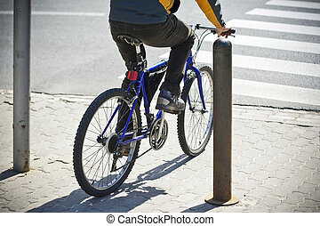 Bike rider - Undefined  bike rider crossing street.