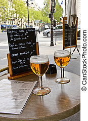Two glasses of beer on the table of street cafes. Restaurant...