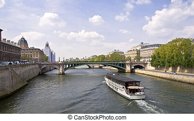 Passenger ship boat sails on the river Seine. View from the...