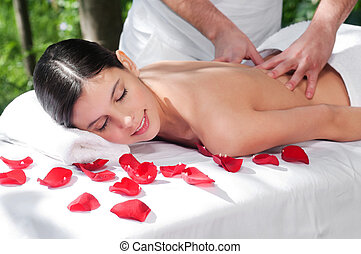Young woman getting a back massage - Beautiful woman getting...