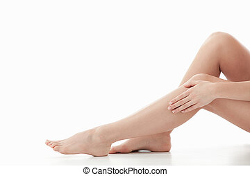 Body parts - Beautiful legs on a white background