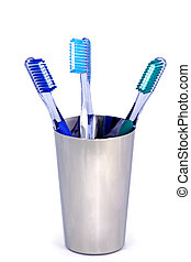 three toothbrushes in a metal cup