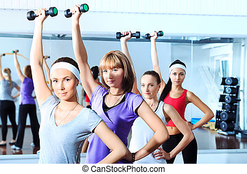 fitness women - Group of young women in the gym centre.
