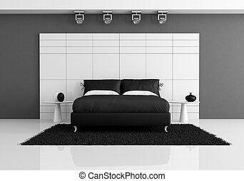black and white bedroom with double bed against white panel...