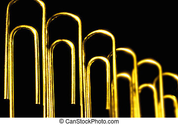 Paperclips Against Black Background