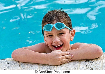 Having fun in the pool - 5 year old kid laughing in a...