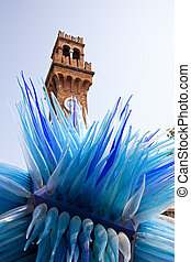Huge artwork outside with tower in Murano near Venice in Italy