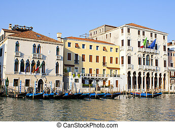 Several gondolas on grand canal in Venice in Italy