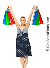 Happy pregnant woman at shopping raising her hands with...