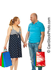 Pregnant couple at shopping - Future parents holding...