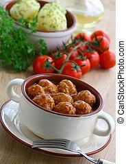 Meatballs in tomato sauce.