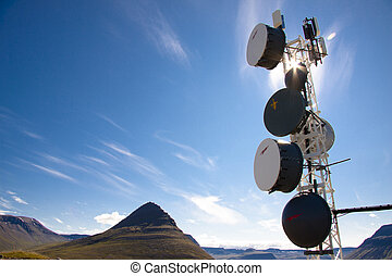 Blue sky sunlight and cell antenas - Iceland - Iceland -...