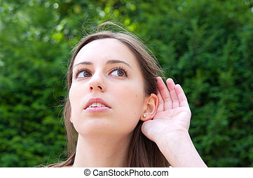 Relying on hand-ear listening young woman in the streets of...