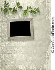 Wooden frame hanging from a tree branch on the grunge background