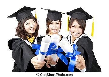 three graduation asian girls holding their diploma