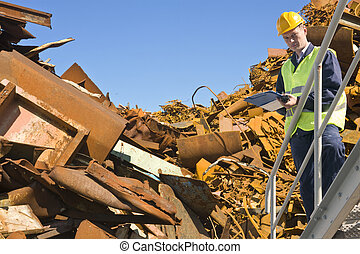 Recycling expert, standing on a metal staircase in front of...