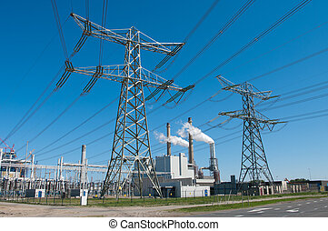 power plant - electricity pylons and power plant in...