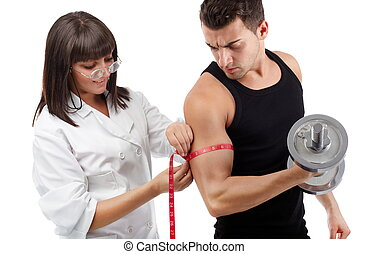 Measuring his hard workout - Pretty young nurse measuring...