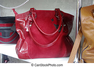 red suede womens bag on shelf