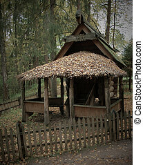 traditional old izba in forest