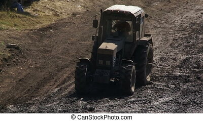 Race through the mud - Tractor ride to the distillation of...
