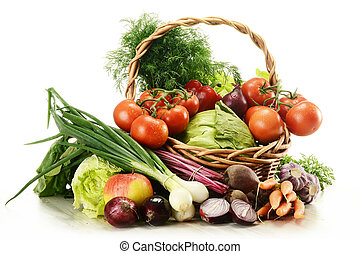 Composition with raw vegetables and wicker basket isolated...