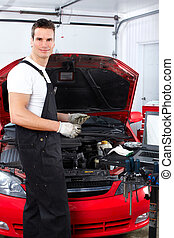 Auto repair - Handsome mechanic working in auto repair shop.