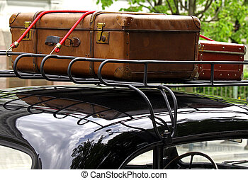 Vintage suitcases as seen on the old vintage car roof