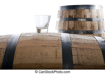 whiskey glass on wooden barrel - Whiskey glass on a whiskey...