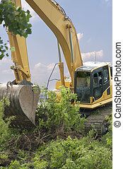 Heavy Equipment Strips Vegetation - Heavy equipment strips...