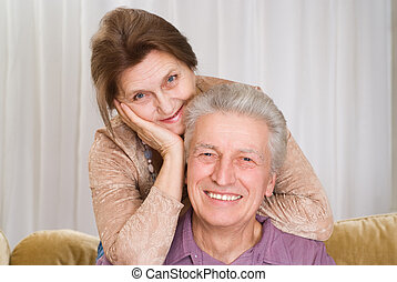 happy elderly couple together on a white