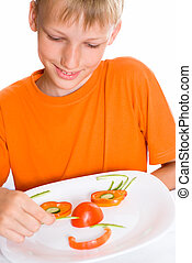 boy and plate with vegetables on white background