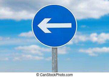 Arrow sign against blue sky