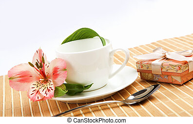 White cup with pink flowers