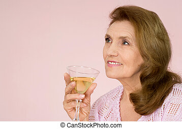 Pretty old woman on a pink background