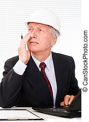 old builder in the helmet on a white background