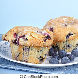 Blueberry Muffins - Blueberry muffins with blueberries on a...