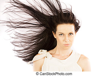 Hair blow - Face shot of brunette girl with hair blowing on...