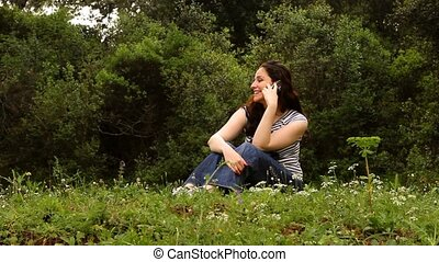 beautiful girl talking on the phone in countryside 2